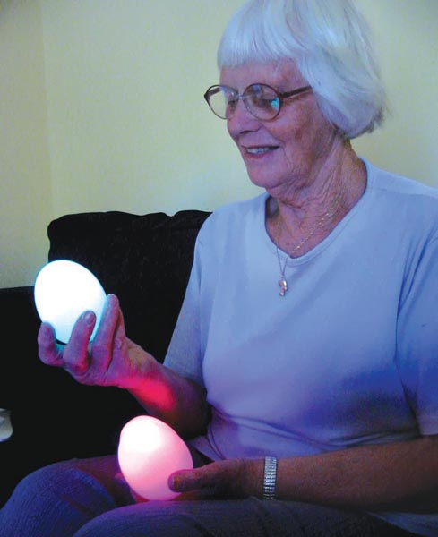 Ian's Mum holding glowing Oggs